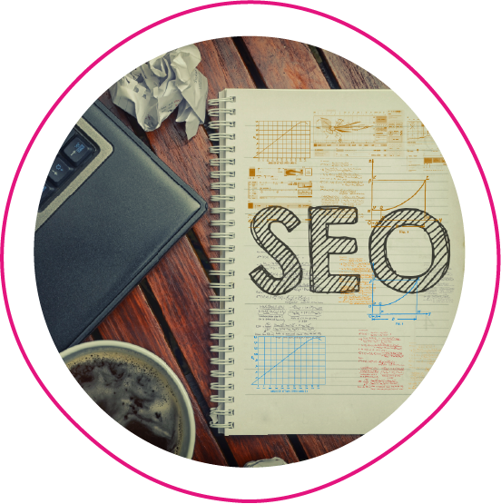 Notebook with the word SEO doodled in the middle of a page of notes