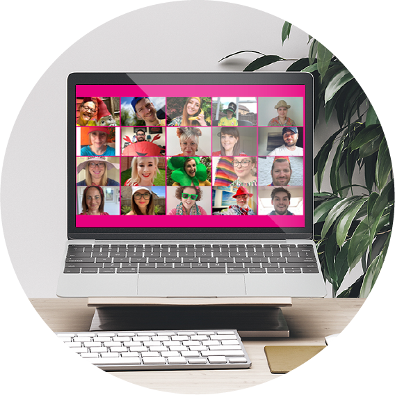 members of WSA staff shown on a laptop having a virtual meeting wearing bright colours and hats