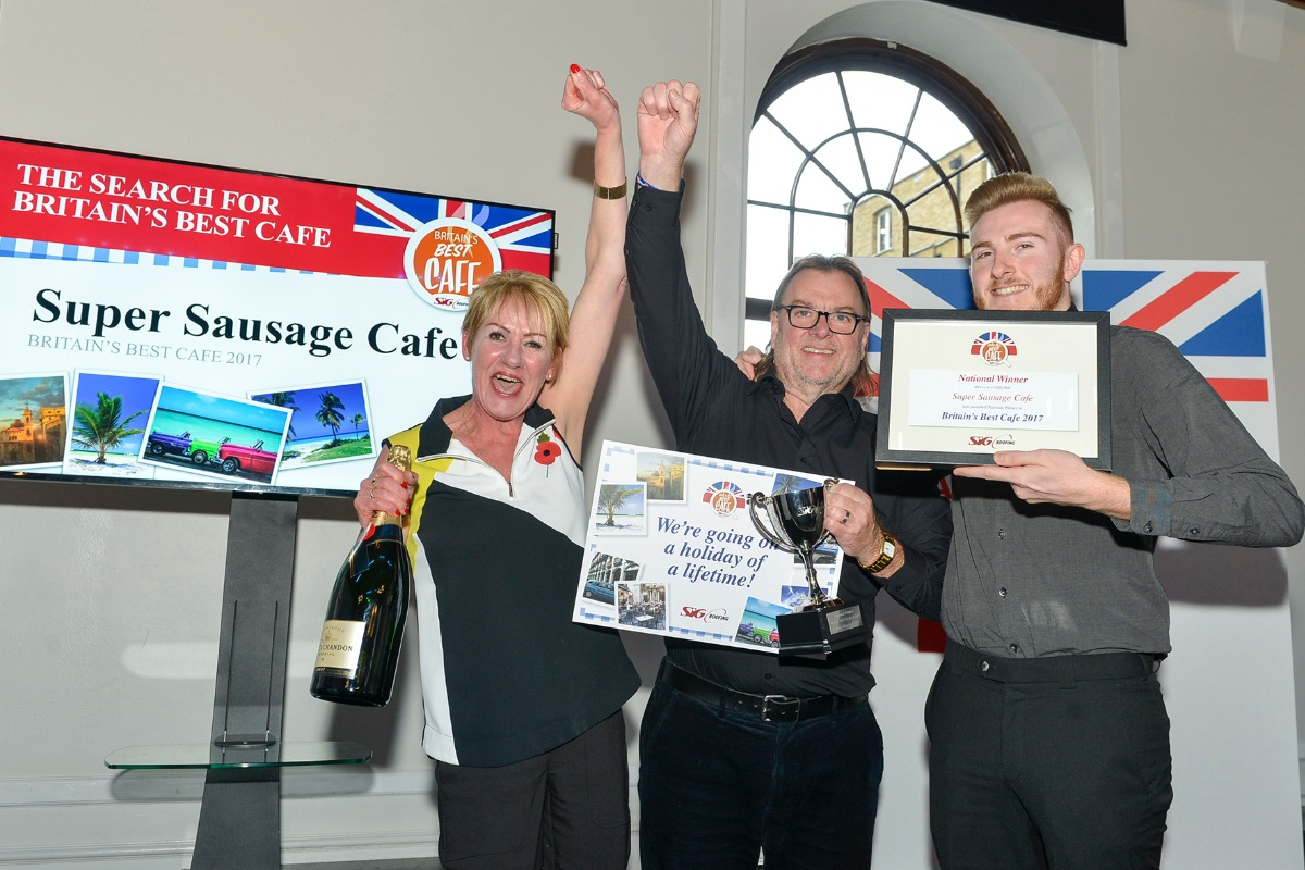 The winners of 'Britain's Best Cafe', Super Sausage Cafe, holding their certificate and trophy